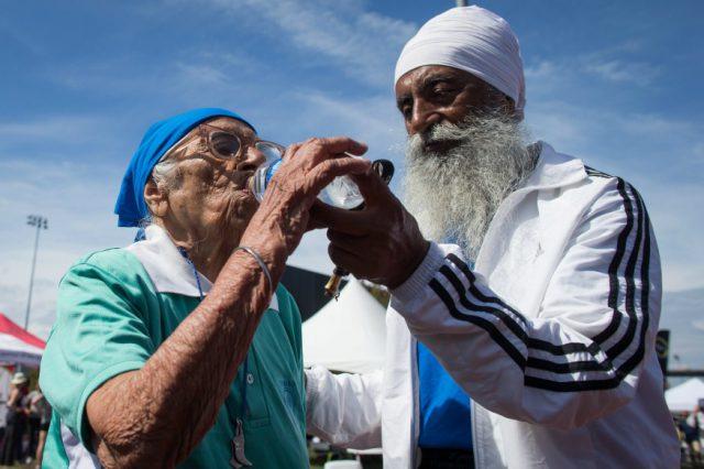 Man Kaur, 101, with her son Gurdev Singh.